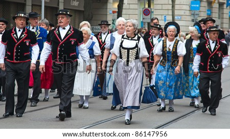 ZURICH - AUGUST 1: Representatives  of canton Appenzell in national costumes march at the Swiss National Day parade on August 1, 2009 in Zurich, Switzerland. - stock photo