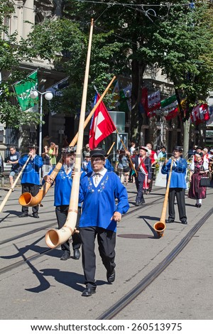 ZURICH - AUGUST 1: Swiss National Day parade on August 1, 2012 in Zurich, Switzerland. Representaives of cantone Glarus in historical costumes. - stock photo
