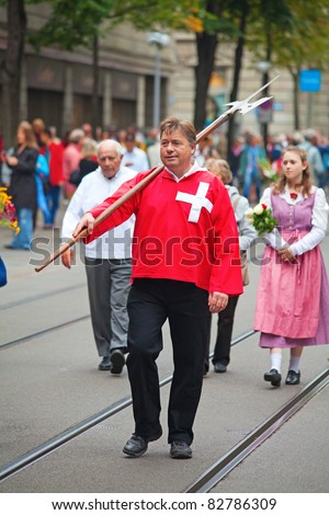 ZURICH - AUGUST 1: Swiss National Day parade on August 1, 2009 in Zurich, Switzerland. Representative of canton Schwyz in the national costumes. - stock photo
