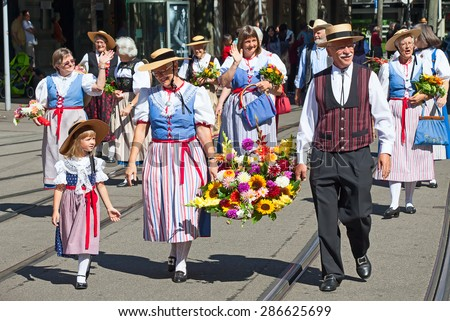 ZURICH - AUGUST 1: Swiss National Day parade on August 1, 2009 in Zurich, Switzerland. Family in a historical costumes. - stock photo
