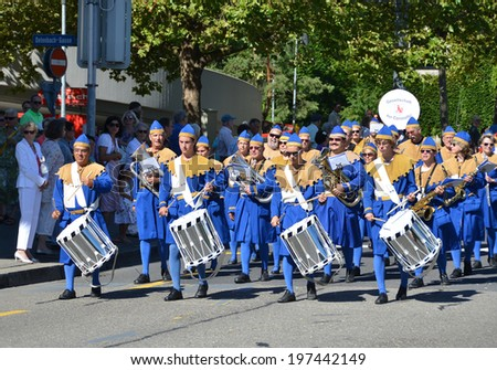 ZURICH - AUGUST 1, 2013: Traditional parade in Zurich on the Swiss National Day, August 1 in Zurich - stock photo