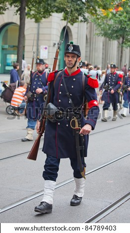 ZURICH - AUGUST 1: Unidentified man in historical costume representing Swiss army of the 19th century at Swiss National Day parade on August 1, 2009 in Zurich, Switzerland. - stock photo