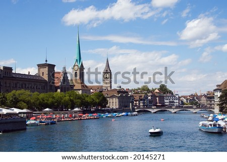Zurich cityscape (Limmat river & Fraumuenster) - stock photo