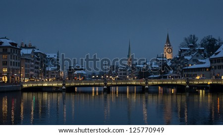 Zurich covered by snow at night - stock photo