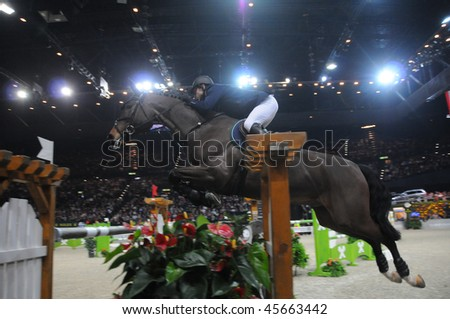 ZURICH - JANUARY 31: Denis Lynch (IRL) in action during the ROLEX FEI World Cup on January 31, 2010 in Zurich. - stock photo