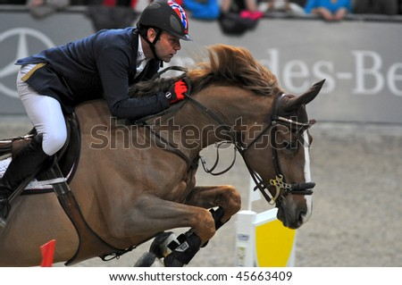 ZURICH - JANUARY 31: Geir Gulliksen (NOR) in action during the ROLEX FEI World Cup on January 31, 2010 in Zurich. - stock photo