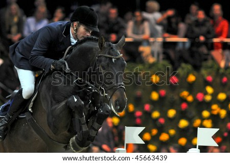 ZURICH - JANUARY 31: Svante Johansson (SWE) in action during the ROLEX FEI World Cup on January 31, 2010 in Zurich.