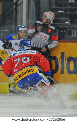ZURICH - JANUARY 13, 2009: ZSC Lions vs. Kloten Flyers 5:1 - Players in action, during game valid of the qualification phase of the NLA, won by the ZSC Lions (r) against the Kloten Flyers (w).