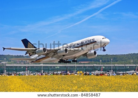 ZURICH - MAY 24: Crowd watching the world biggest aircraft A-380 taking off from Zurich airport on May 24, 2010 in Zurich, Switzerland - stock photo