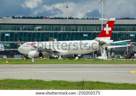 ZURICH - September 21:  Planes preparing for take off at Zurich Airport on September 21, 2014 in Zurich, Switzerland. Zurich airport is home port for Swiss Air and one of the biggest european hubs. - stock photo