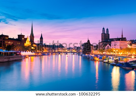 Zurich Skyline and the River Limmat in the Evening (Switzerland) - stock photo
