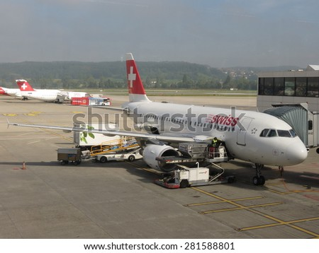 ZURICH, SWITZERLAND - CIRCA SEPTEMBER 2013: Swiss Airlines aircraft parked at the airport - stock photo