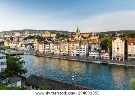 ZURICH, SWITZERLAND - JULY 4: Famous postcard view of various houses and churches in the old town part of Zurich at sunset on July 4, 2015. Zurich is the biggest city in Switzerland.