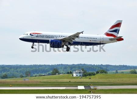 ZURICH, SWITZERLAND - MAY 25, 2014: British Airways landing at Zurich international airport on May 25, 2014. Zurich International Airport is one of the major Europian Hubs.  - stock photo