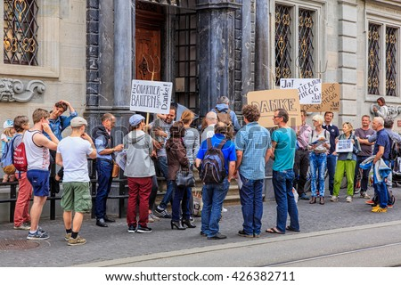 Zurich, Switzerland - 25 May, 2016: people with banners at the entrance to the Zurich Town Hall. Zurich Town Hall (German: Zurich Rathaus) houses the cantonal parliament and the city parliament.