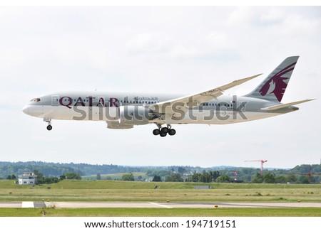 ZURICH, SWITZERLAND - MAY 25, 2014: Qatar airplane landing at Zurich international airport on May 25, 2014. Zurich International Airport is one of the major Europian Hubs.  - stock photo