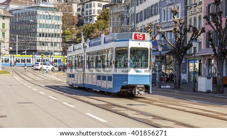 ZURICH, SWITZERLAND, on MARCH 26, 2016. Typical urban view in the spring morning. The tram moves down the street