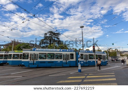 ZURICH, SWITZERLAND - SEP 21, 2014: Trams make an important contribution to public transport in the city of Zurich in Switzerland. Trams within city are operated by the Verkehrsbetriebe Z?rich (VBZ). - stock photo