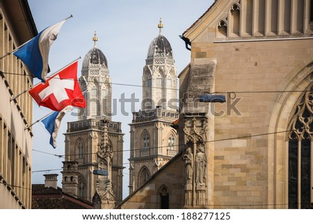 Zurich, Switzerland - The Grossmunster towers behind Fraum���¼nster church, shot from Paradeplatz - stock photo