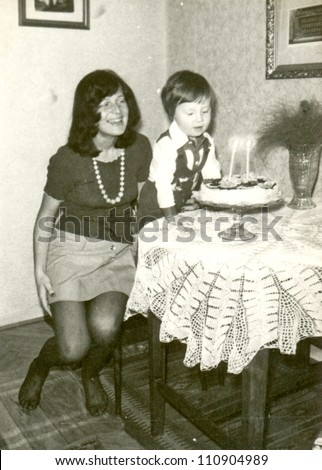 ZVOLEN, CZECHOSLOVAKIA, CIRCA 1975 - happy birthday (two years old child and his mother) - circa 1975 - stock photo