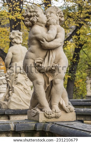 Zwinger is a palace in Dresden, eastern Germany, built in Rococo style in 17th century. Designed by court architect Matthaus Daniel Poppelmann. Nymphenbad (Nymph Bath). Sculptures. - stock photo
