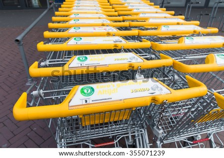 ZWOLLE, NETHERLANDS - MARCH 22, 2015: Yellow Jumbo shopping carts. Jumbo employs about 30,000 people. - stock photo