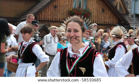 ZYWIEC, POLAND - AUG 5: Participants of the 47th Beskidy Highlanders Week of Culture (TKB), the biggest folk culture event in Eastern Europe, parade through the city, folk group from Italy on August 5, 2010 in Zywiec, Poland