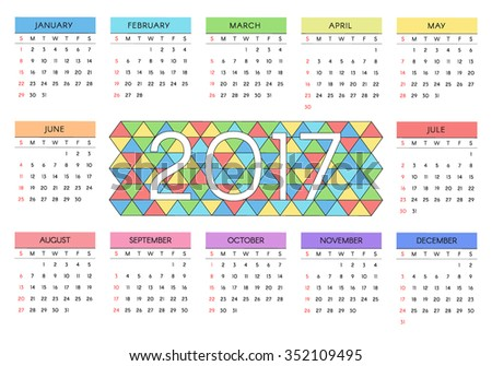 2017 calendar with colorful triangles on the background. The week starts with Sunday. Vector illustration for your design