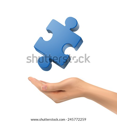 3d hand holding jigsaw puzzle piece over white background