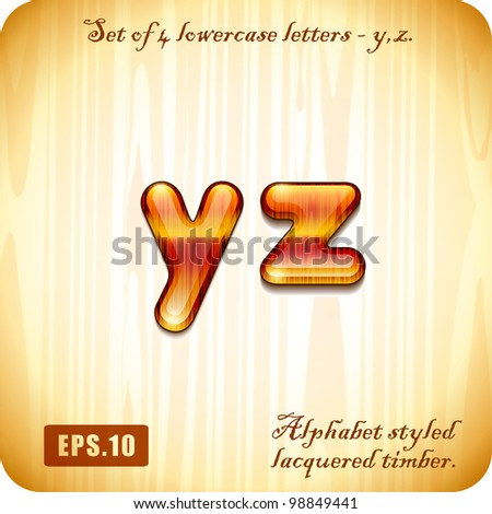 "3d Joyful Decorative lacquer set of 4 lowercase letters ""y"", ""z"" alphabet styled expensive wood. Eps 10."