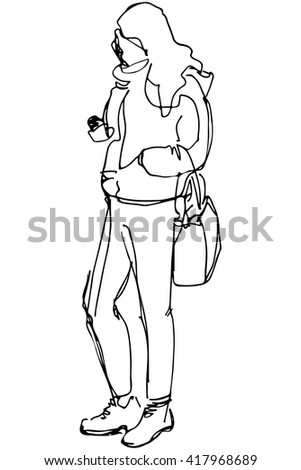 girl with a bag looking at phone