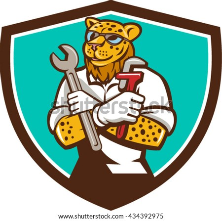 `Illustration of a leopard mechanic holding spanner and monkey wrench with arms crossed viewed from front set inside shield crest on isolated background done in cartoon style.  - stock vector