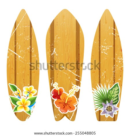 3 wooden surfboards with floral prints