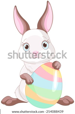 A cute Easter bunny standing near brightly colored egg - stock vector