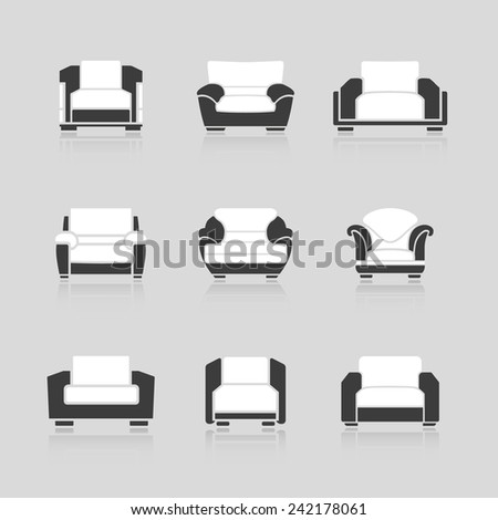 A set of black and white armchairs on a white background. Vector - stock vector