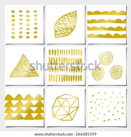 A set of nine abstract geometric designs in white and golden. Brush strokes, doodles, organic patterns and shapes. - stock vector