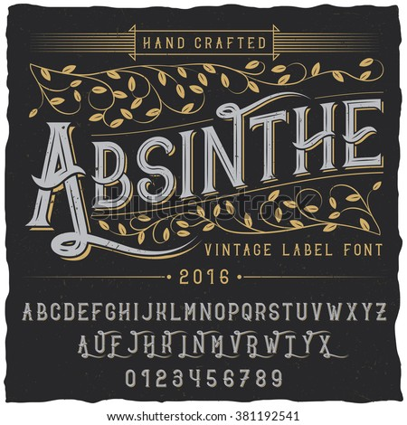 Absinthe label font and sample label design with decoration and ribbon. Vintage font. Whiskey font. Fine label font. Handcrafted font. Decoration font. Font style. Retro font. Old font - stock vector