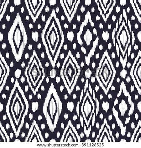 Abstract background in the ethnic style. Black and white Ikat seamless pattern for textile, wallpaper, card or wrapping paper. - stock vector
