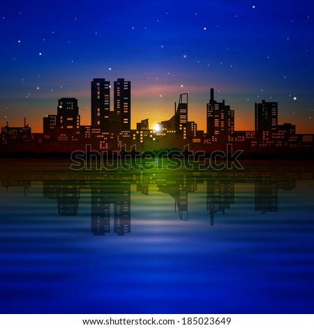abstract blue background with silhouette of city and golden sunrise