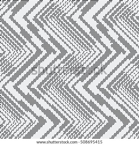 Abstract dotted zigzag motif. Seamless pattern.