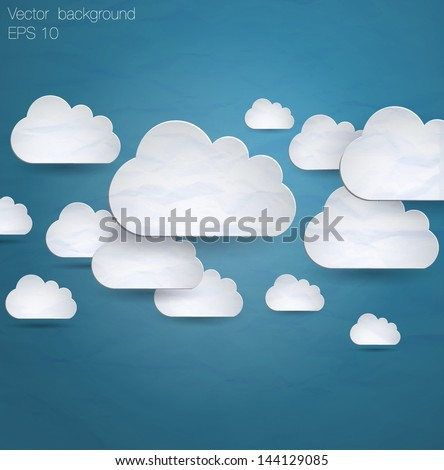 Abstract paper speech bubbles in the shape of clouds used in a social networks on dark blue background. Cloud computing concept.