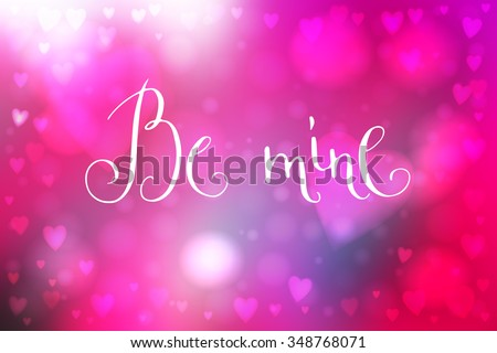 Abstract smooth blur pink background with heart-shaped lights over it and hand written Valentine's day words.