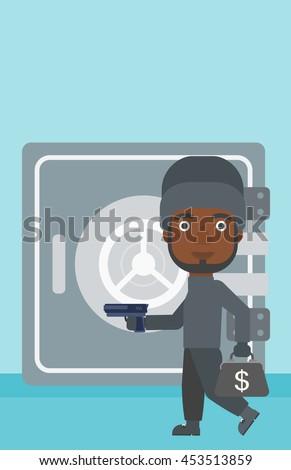 An african-american burglar in mask near the big safe door. Burglar holding hand gun and a bag with dollar sign. Thief stealing money. Vector flat design illustration. Vertical layout. - stock vector