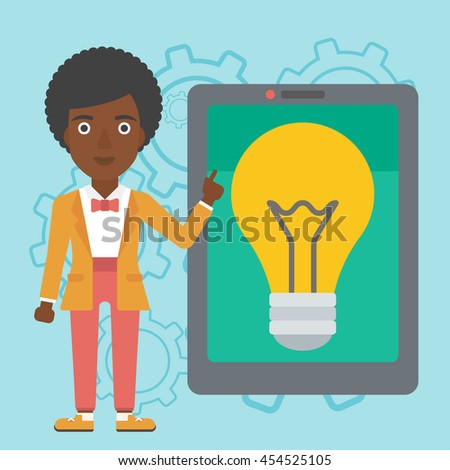 An african-american woman  pointing at a big tablet computer. Woman standing near a big tablet computer with a light bulb on a screen. Vector flat design illustration. Square layout. - stock vector
