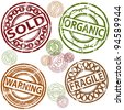 An image of a set of sold, organic, warning and fragile rubber stamps. - stock photo
