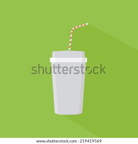 an isolated plastic cup with a milk shake on a green background