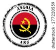 Angola grunge flag on button stamp  - stock photo