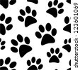 Animal footprint seamless pattern. - stock vector