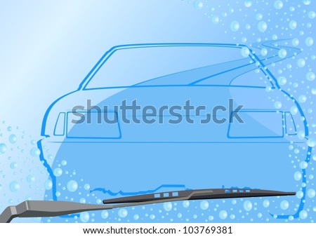 Automotive windshield wiper on the glass with drops of water, roads and abstract vehicle