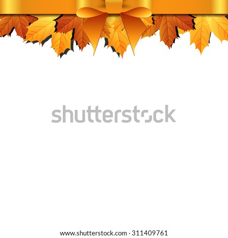Autumn leaves decorated with gold bow